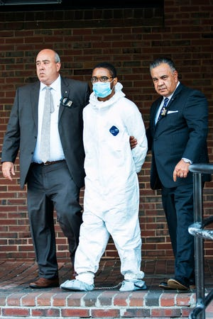 Tyrese Haspil, 21, is escorted out of the 7th precinct by NYPD detectives, Friday, July 17, 2020, in New York. Haspil faces a murder charge in the death of Fahim Saleh, 33-year-old tech entrepreneur who was found dismembered inside his luxury Manhattan condo. (AP Photo/Eduardo Munoz Alvarez)