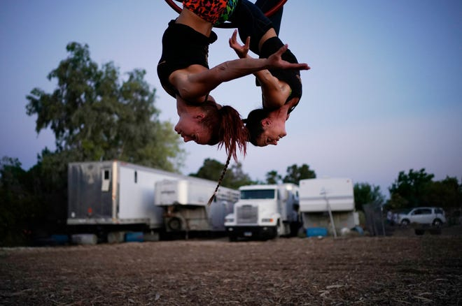 """Lisa Varmbo Martonovich, left, and Nicole England-Czyzewski practice an aerial routine for """"Gladius The Show,"""" a touring equestrian and acrobatic show, Thursday, May 28, 2020, in Las Vegas. The coronavirus forced the producers to cancel all of their performances through 2020."""
