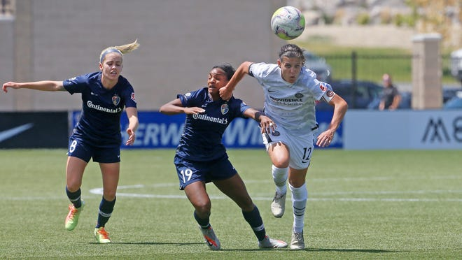 Portland Thorns' Christine Sinclair (12) battles with North Carolina Courage forward Crystal Dunn (19) during the second half of an NWSL Challenge Cup soccer match at Zions Bank Stadium Friday, July 17, 2020, in Herriman, Utah.