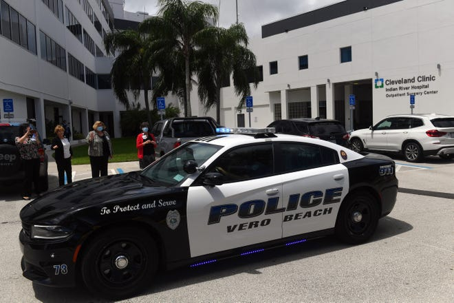 Indian River County law enforcement and emergency personnel turn their lights and sirens on while making a lap around Cleveland Clinic Indian River Hospital on Friday, July 17, 2020, as a way to say thank you to all the medical staff working around the clock during the COVID-19 pandemic.