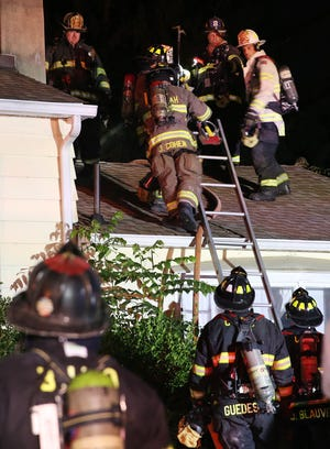 Croton Falls firefighters work at the scene of a house fire at 7 Daniel Road in North Salem July 16, 2020. Firefighters from  Bedford Hills, South Salem, Somers, Katonah and Goldens Bridge assisted at the scene. Firefighters had the blaze under control in about 20 minutes.