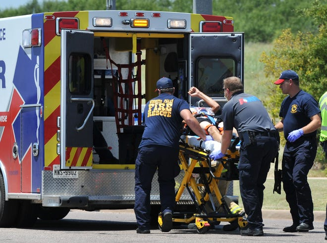 Wichita Falls emergency medical responders work to transport the rider of a motorcycle that was involved in an accident on Seymour Highway near Tanglewood Blvd. to the hospital Friday afternoon.The accident happened shortly before 1 p.m.