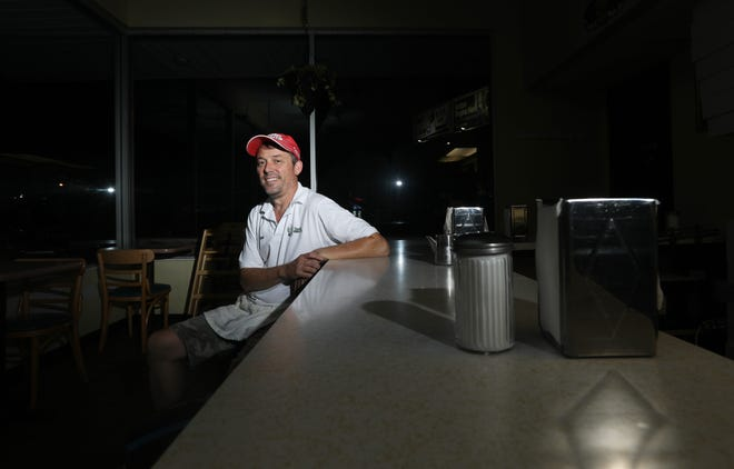 Tom Warne has been working at Donald's Donuts since he was a teenager, and arrives at work well before dawn to start making donuts every day. Warne purchased the business in 2007 from his parents, who started it in 1960.