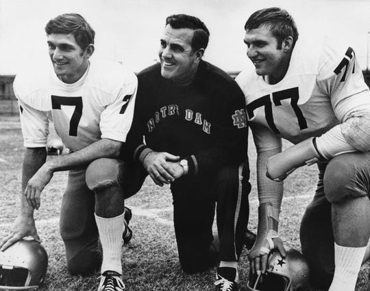 Notre Dame head football coach Ara Parseghian, center, poses with Quarterback Joe Theismann (7), left, and All-America defense tackle Mike McCoy in 1969.