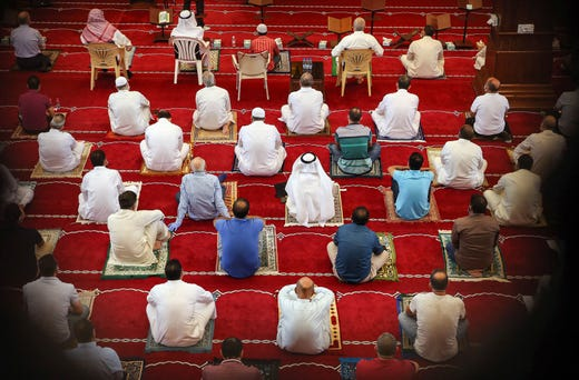 Muslim worshippers, distanced safely from each other and clad in face masks due to the COVID-19 coronavirus pandemic, attend a sermon during the Friday prayers at a mosque in Kuwait City on July 17, 2020.