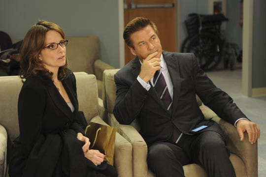 "Tina Fey, left, and Alec Baldwin in the original run of NBC's ""30 Rock."""