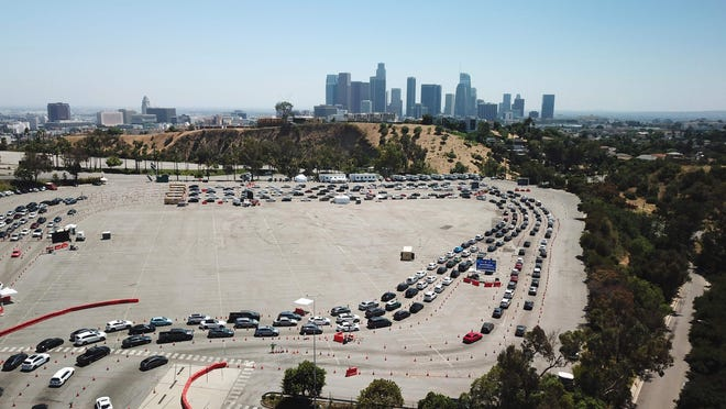 An aerial view shows a long line of cars July 15, 2020, at a COVID-19 testing site at Dodgers Stadium in Los Angeles.