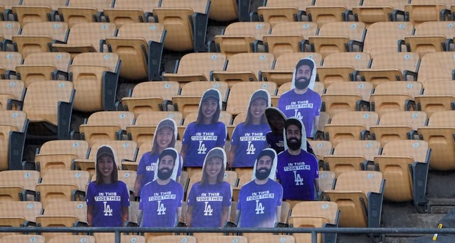 July 15: Cutouts of fans in the stands at Dodger Stadium.