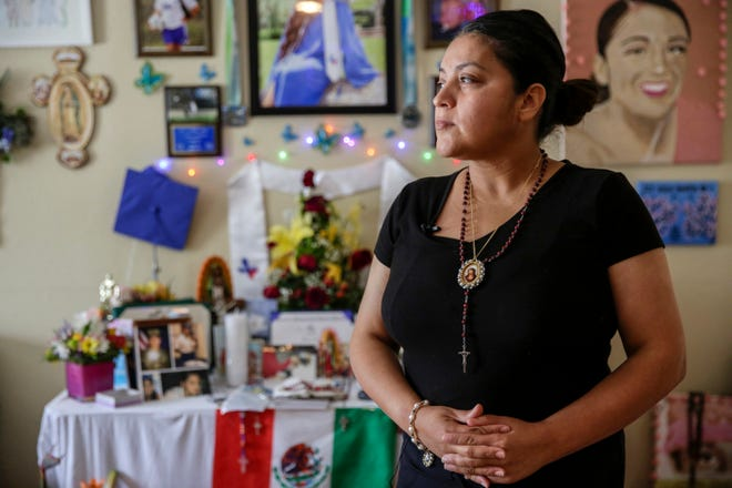 """Gloria Guillen stands for a portrait near an altar dedicated to her daughter Spc. Vanessa Guillen at their home in Houston on Thursday, July 9, 2020. Gloria said she and Vanessa were very close. """"I know this is not going to bring back my daughter,"""" Gloria said of the investigation. """"But justice will be done in the name of Jesus and the Holy Mary, justice will be done."""""""