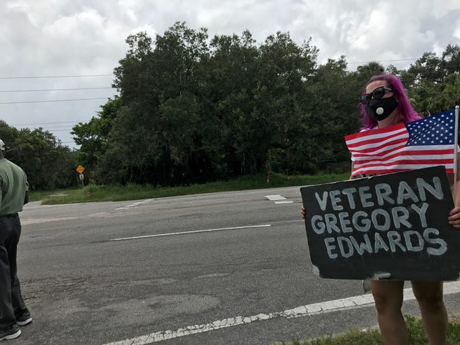 A small group of protestors, met by a single counter protestor, gathered to raise attention to the case of Gregory Edwards, a combat veteran who died at the Brevard County Jail.