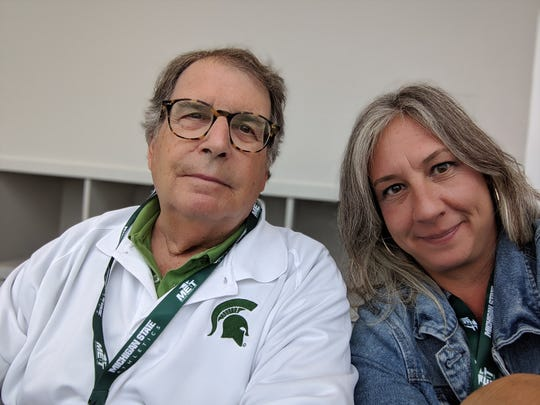 Stanley Soffin attends his final Spartan football game with daughter Anne Soffin. Soffin, the former director of the Michigan State University School of Journalism and a Michigan Journalism Hall of Fame member, died on July 8, 2020. He was 78.