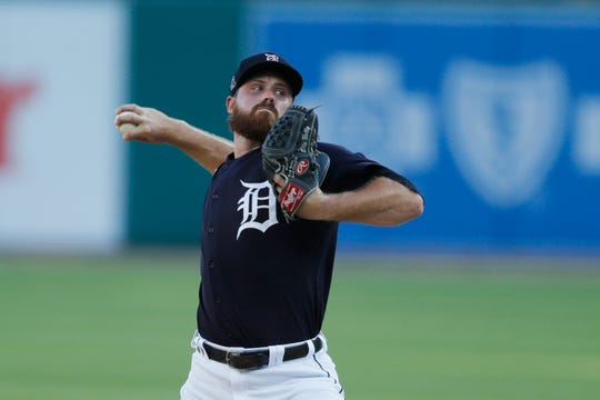 Detroit Tigers pitcher Buck Farmer throws during an intrasquad game on Friday.