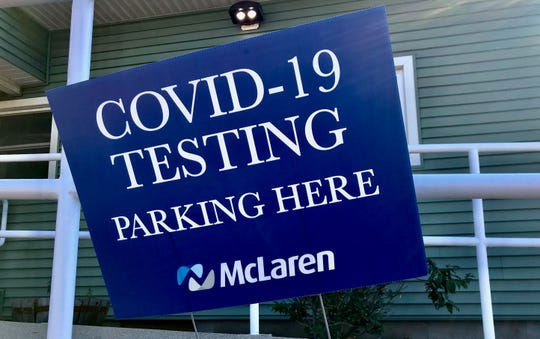 A sign identifies a parking space for those seeking COVID-19 testing at a McLaren urgent care facility in Lansing on Friday, July 17, 2020.
