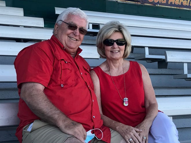 Billings residents John and Karen Shelhamer get ready to watch their grandson, Caden Dowler of the Billings Mustangs, as the Scarlets warmed up to face the Great Falls Chargers in an American Legion game at Centene Stadium Saturday.