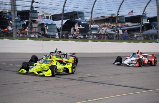Jul 17, 2020; Newton, Iowa, USA; Indy Series driver Simon Pagenaud (22) leads driver Ed Carpenter (20) during the Iowa Indycar 250 at Iowa Speedway.