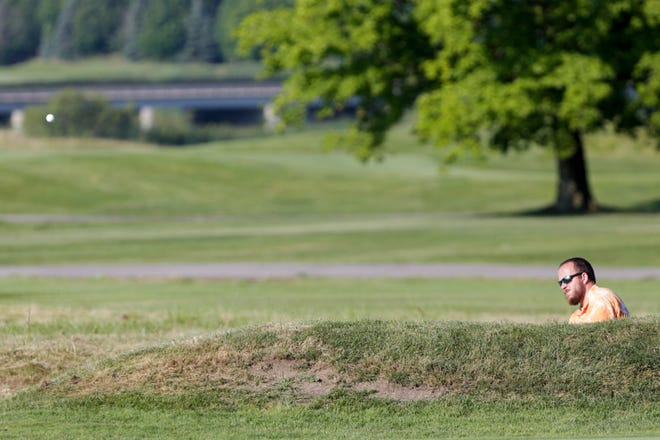 Earl Emerick chips on hole four during the first round of the 2020 Men's City Golf Championship, Saturday, July 18, 2020 at Birck Boilermaker Golf Complex in West Lafayette.