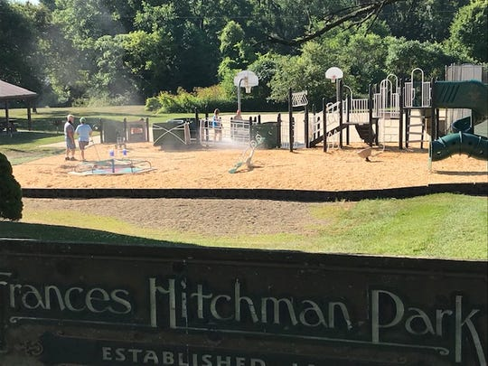 Terry Hitchman and his wife Tammy, Joanne Lifer and other volunteers on Saturday spruced up Hitchman Park's new handicapped-accessible playground equipment that was installed earlier this month.