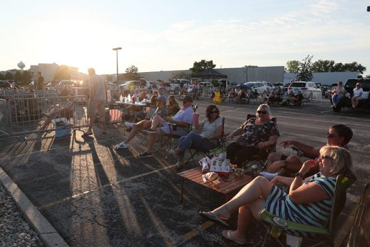 People watch Conner Sweet on Friday, July 17, 2020, during Kapco Metal Stamping's 'Live at the Lot' drive-in concert series in Grafton.