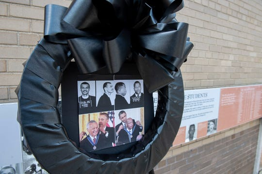 A wreath honoring civil rights icons John Lewis and C.T. Vivian sits outside the Freedom Rides Museum in Montgomery, Ala., on Saturday, July 18, 2020.