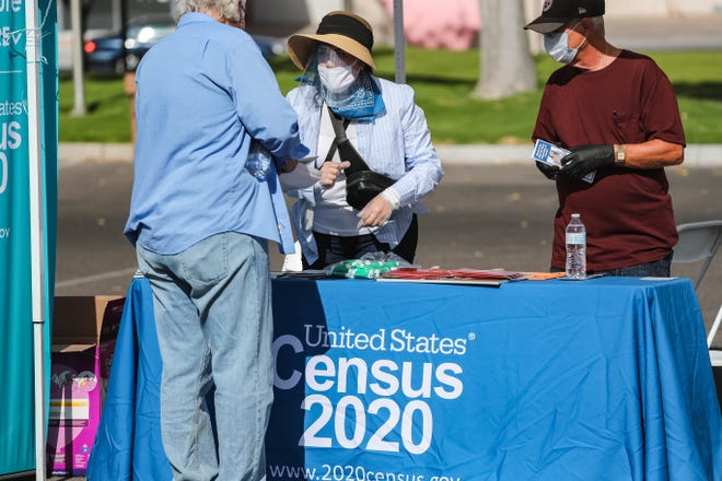 Census-takers set up a booth at a free face mask and sanitation kit giveaway event at the parking lot of Thomas Branigan Memorial Library in Las Cruces on Saturday, July 18, 2020.