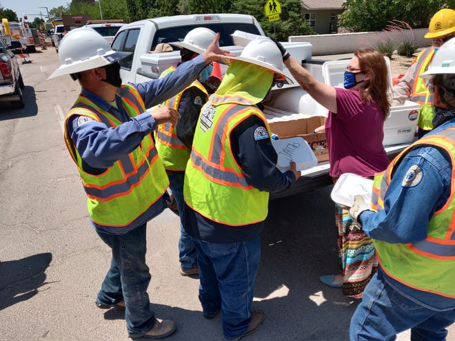 Assistant Las Cruces Utilities Director Delilah Walsh hands out food to associates on the job in downtown Las Cruces. The meals, provided by Santa Fe Grill, were a way to say thank you to LCU gas workers who stay up-to-date on training to make sure that gas distribution in Las Cruces is safe for all residents.