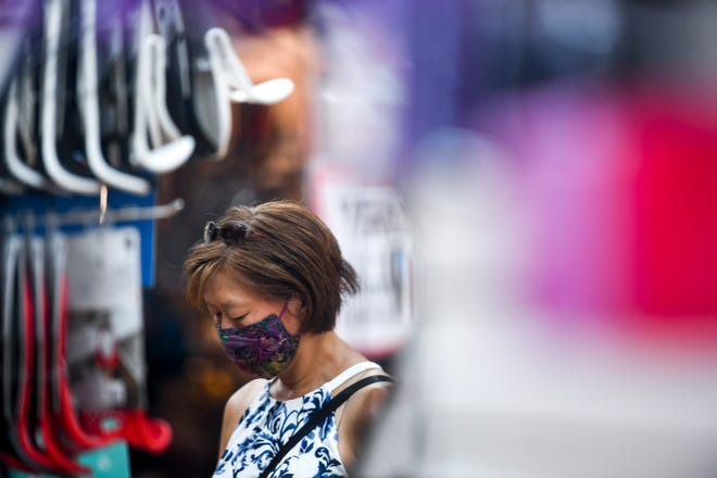 Kim Corcoran walks around Zandbroz Variety on Saturday, July 18, 2020 in Sioux Falls, S.D. The store has required customers to wear masks to prevent the spread of COVID-19.