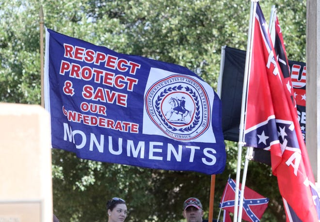 Outside Memorial Auditorium Saturday, July 18, 2020 a group supporting the continued placement of the Confederate Sons of the Southland memorial monument collected signatures for their petition.