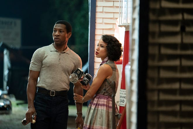 "Atticus Freeman (Jonathan Majors) and his friend Letitia (Jurnee Smollett) travel across the Jim Crow South to find his missing father in ""Lovecraft Country."""