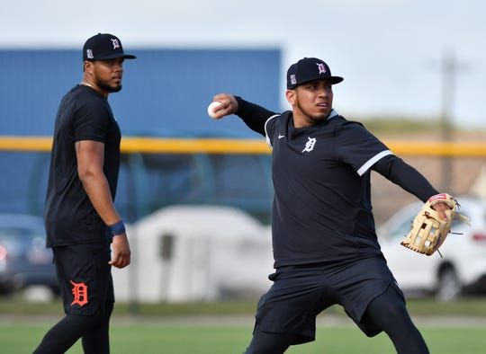 Tigers third baseman Jeimer Candelario watches Isaac Paredes make a throw to first base during spring training in Lakeland, Fla., in February.