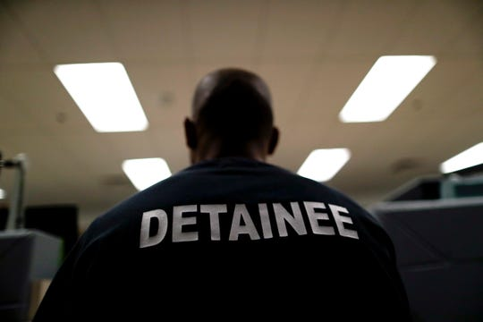 A detainee sits at the Otay Mesa Detention Center in San Diego. The facility was at the center of the first big novel coronavirus outbreak at a U.S. immigration detention center in April 2020.
