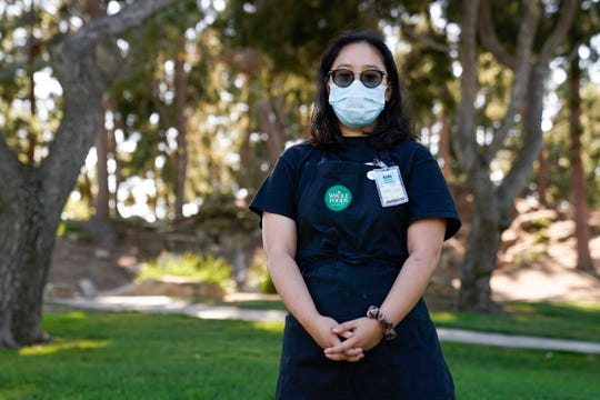 Katie Doan, a former Whole Foods employee, poses for a photo in Costa Mesa, Calif. Doan started tracking COVID-19 cases at Amazon-owned Whole Foods in April.
