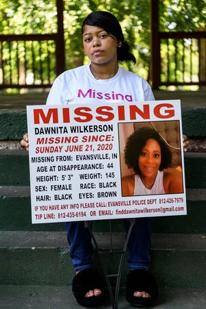 Kiahnna Wilkerson holds a yard sign with details about her mother Dawnita Wilkerson who has been missing since June 21, 2020. Her family is searching for answers on her whereabouts and is asking the community to send any tips to finddawnitawilkerson@gmail.com or call the tip line at (812)-435-6194 and the Evansville Police Department.