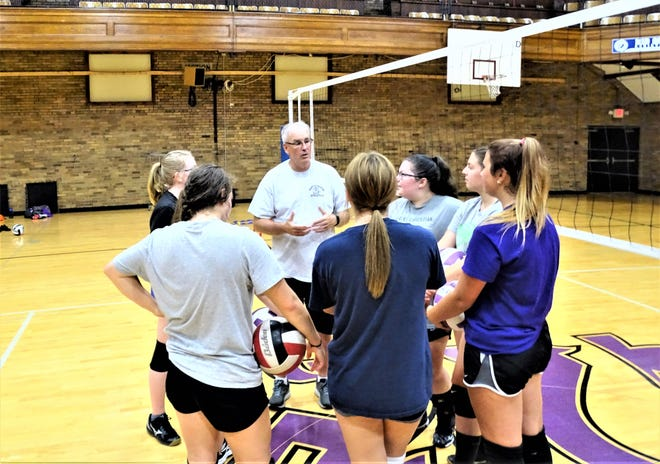 New Granville Christian Academy volleyball coach Mike Miller talks with his players during an open gym workout in Newark.