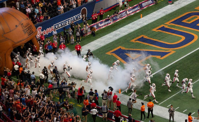 Auburn players come onto the field prior to the Chick-fil-A Kickoff Game vs. Washington at Mercedes-Benz Stadium, Saturday, September 1, 2018, in Atlanta.