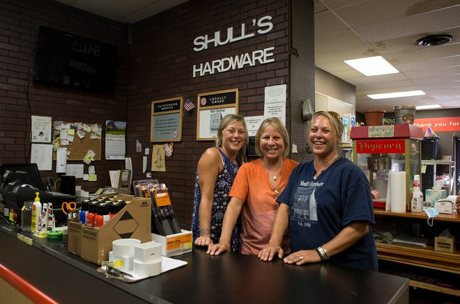 Sisters Laney Lainge and Lindsey BeVier stand on either side of their mother, Judy Shull. The family runs Shull's Hardware in Johnstown but are selling the family business after the death of their father and husband, Mike Shull.