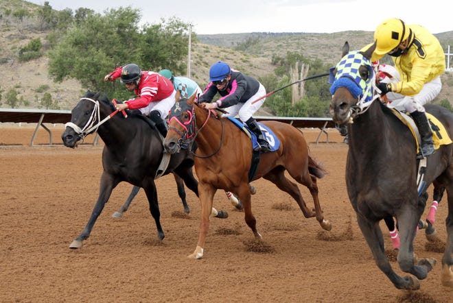 Champito, center, races at the Ruidoso Downs Rainbow Derby on July 19, 2020. The Ruidoso Downs Race Track will open its season Memorial Day Weekend this year and will have its casino reopened March 22 after being closed since the COVID-19 pandemic began last year.