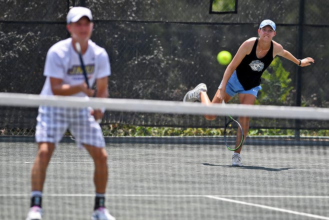 Elizabeth Scotty serves as she and Holden Koons face Eva Frissora and Sanam Singh in the annual Mixed Doubles Charity Classic tennis finals at the Country Club of York, Sunday, July 19, 2020