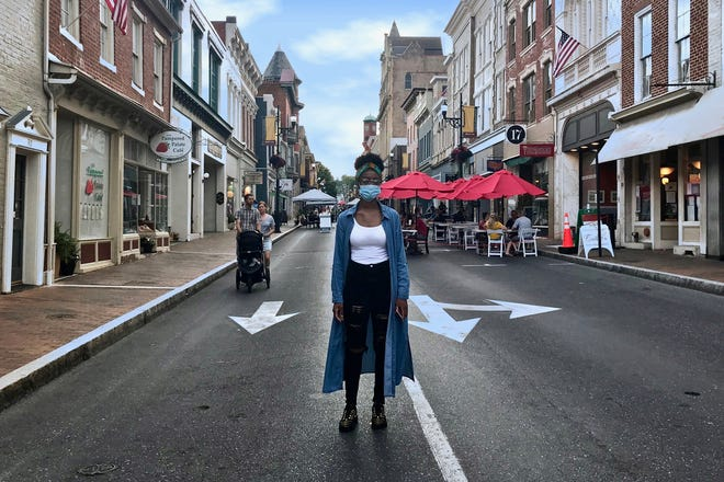 Rev. Jazmine Brooks, 2nd Vice President of the Staunton Branch of the NAACP, stands in the middle of Beverley Street in downtown Staunton, Virginia