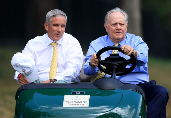 PGA Tour Commissioner Jay Monahan, left, and Jack Nicklaus ride in a cart during the first round of The Memorial Tournament on July 16, 2020 at Muirfield Village Golf Club in Dublin, Ohio.