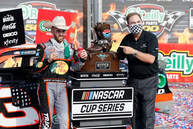 Austin Dillon, left and Texas Motor Speedway President and General Manager Eddie Gossage, right, celebrate in Victory Lane after the NASCAR Cup Series auto race at Texas Motor Speedway in Fort Worth, Texas. RAY CARLIN/AP