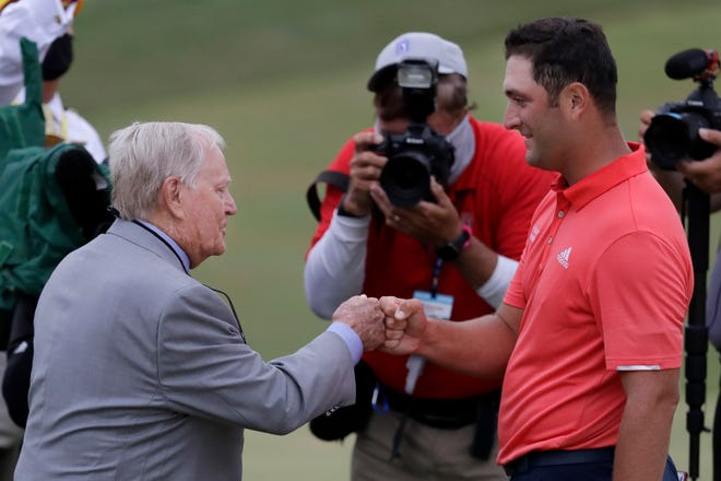 Jon Rahm is congratulated by Jack Nicklaus after winning the Memorial golf tournament. DARRON CUMMINGS/AP
