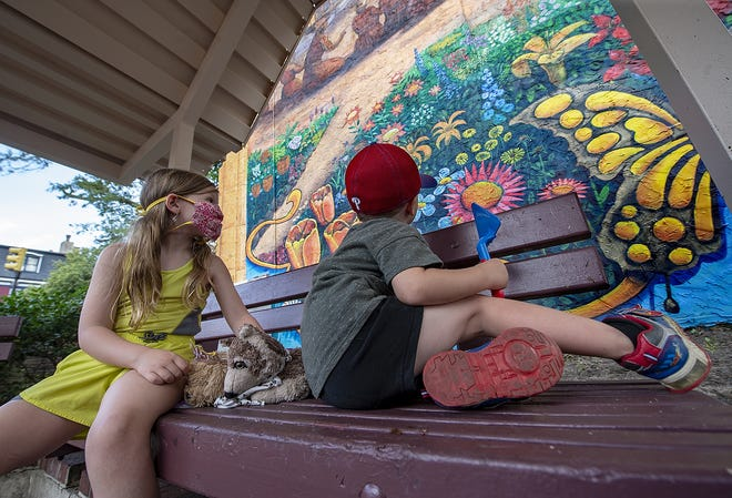 "Looking at the ""Spring by the River"" mural, were Reagan Westfield, left, 6, and her brother, Nolan, 3, of Philadelphia. The pair were visiting their grandparents, in Burlington City."