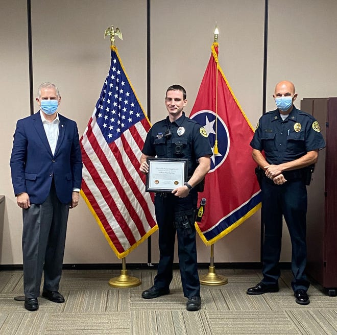 Officer Randy Cox, center, was the recipient of the department's Life Saver Award for his actions on June 10.