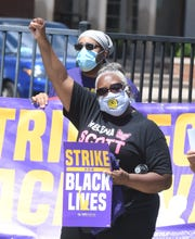 SEIU Healthcare Michigan holds a rally, with some employees walking off the job for the event, in front of Hartford Nursing and Rehabilitation Center in Detroit.