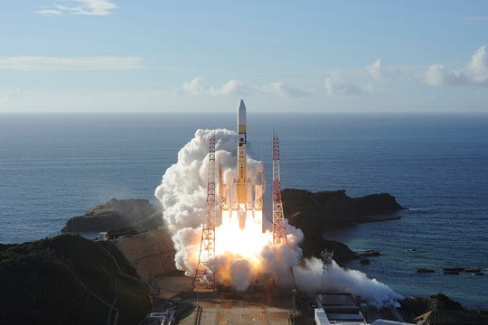 In this photo released by MHI, an H-IIA rocket with United Arab Emirates' Mars orbiter Hope lifts off from Tanegashima Space Center in Kagoshima, southern Japan Monday. (MHI via AP)