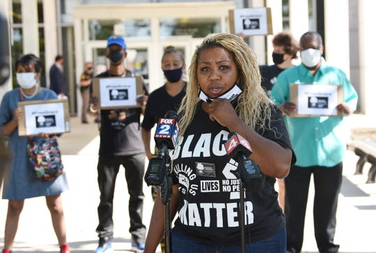 """Cherisie Evans of Michigan Liberation Action Fund urges Oakland County Judge Mary Ellen Brennan to release 15-year old """"Grace"""" from juvenile detention during a press conference outside Oakland County Circuit Court, Monday, July 20, 2020. The judge was holding a review of the case inside the court."""