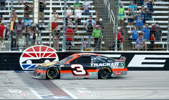 Austin Dillon crosses the finish line to win the NASCAR Cup Series race at Texas Motor Speedway.