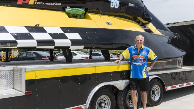 Scott Pierce poses with his Grand Prix hydroplane in 2017.