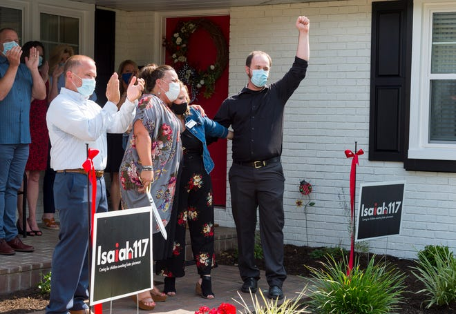Isaiah 117 House officials celebrate after cutting a ribbon during an official opening in Evansville, Ind., on July 20, 2020.