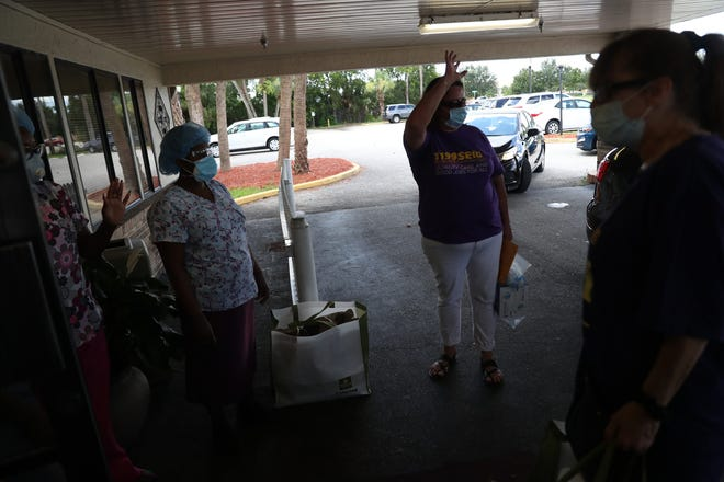 """Members of the 1199SEIU United HealthCare Workers East visited three Southwest Florida nursing homes to call for racial justice, present a """"Protect All Workers"""" bill of rights, and recognize frontline caregivers during the COVID-19 health crisis. They offered boxed lunches and PPE for staff."""